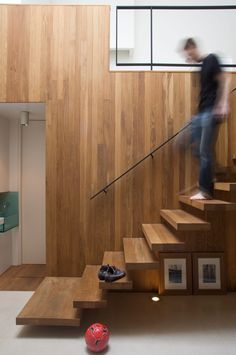 New Mews House | Jonathan Tuckey Design, West London, UK - lye treated oak cantilevered stairs with a mild steel hand rail & balustrade.