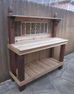 This potting bench is so very simple to make, and so pretty as well as functional. Use 4 x 4's or fence posts with post caps (wood finials), 1 x 4's for the flat surfaces and outside trim boards. She uses cedar which will turn a dark gray, you can also use pressure treated wood and stain it or let it weather gray as well.  Simple and easy to make! Outdoor Furniture, Outdoor Decor, Gardening For Beginners, Bench, Storage, Home Decor, Homemade Home Decor, Gardening For Dummies, Yard Furniture