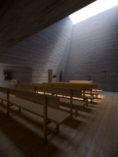 Alpine chapel designed by Joaquim Portela Arquitetos as a giant light funnel