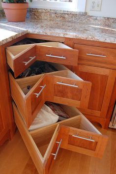 housely cabinets - like the use of the corner space as a drawer instead of turn table