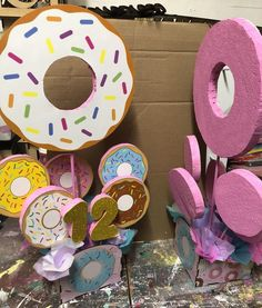 -box is made out of wood -donuts and numbers are made out of foam -can add any color tissue paper-well not be installed, easy to stick on the box