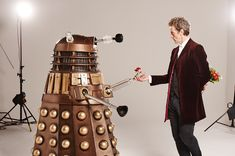 Ahh another one of my favorite Photo Shoots. PCap dressed as the Doctor enjoying the Daleks. I don't think the Daleks know what to think about this aspect of the Doctor. Good Morning and Kissy Kiss my...