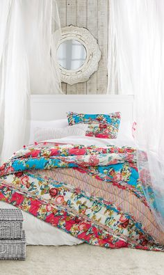 Want to go bold with your bedding? Choose crisp white sheets and a neutral bed frame to let the quilt shine.