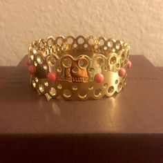 """Louis Vuitton Gold Finish Fashion Bracelet Reposh: authentic Louis Vuitton fashion bracelet, gold finish with coral studs and Louis Vuitton engraving, 8.75"""" in diameter, slip on style. Only worn once between its two owners and in like brand new condition! Gorgeous! Louis Vuitton Jewelry Bracelets"""