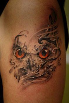 stunning owl tattoo with swirls