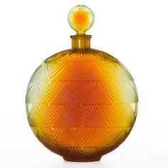 R. LALIQUE Perfume bottle in shaded amber glass for 'Vers le Jour' fragrance by Worth, circa 1926.