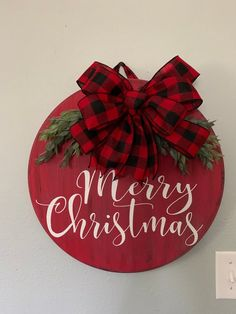 wood Merry Christmas door hanger or wall decor. Embellished with buffalo plaid bow & greenery and will dress your door in style. Christmas Door Decorations, Christmas Wreaths, Christmas Bulbs, Merry Christmas Signs, Christmas Door Hangers, Xmas, Door Hanging Decorations, Christmas Greenery, Front Door Decor
