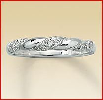 I LOVE this one! My engagement ring is flashy enough, but I don't want a plain band, so this is a great compromise.
