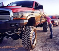#Dodge Ram Lifted Raised Trucks Let's pretend that's me next to my big beast