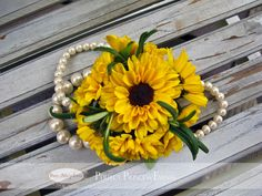 Viking sunflower pom wrist corsage by Perfect Princess Events- diy... perfect for the Mother's on our wedding day. Aqua beads, attach a sunflower, burlap to affix and hold together (maybe?)