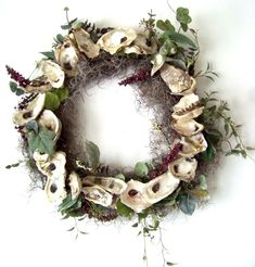 Oyster Shell Door Wreath  Oysters harvested this year in the Oyster harvest at Pass Christian, Ms.  Details:  http://www.backwaterstudio.com/oyster-shell-door-wreath-3.html