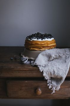 crepe cake filled with whipped mascarpone cream (sweetened with condensed milk) topped with black and blueberries
