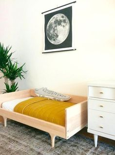 Who says kids can't have cool vintage furniture? Blush dressers, light wood beds and other modern elements can still feel warm and welcoming for little ones.