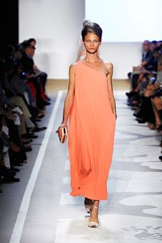 Absolutely perfect! Liluye dress by DVF in neon coral, a perfect perfect long dress!! Chignon hair-do, tan skin, clutch and perfect summer shoes! I would wear this to a wedding or a dinner, it's a fantastic look.