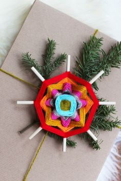 DIY God's Eye snowflakes- for packages or ornaments. @nordstromrack #nordstromrack
