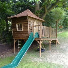 Raised playhouse structure with basket, slide and tyre-swing