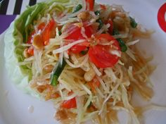 THAI STYLE GREEN PAPAYA SALAD. So excited I think I just found the recipe for a fave dish we have at a local Thai restaurant. They serve this over a fried fish but I want to serve it with baked fish without any breading. Yay!