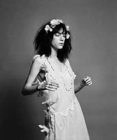 Patty Smith, by Robert Mapplethorpe who was her lover and soul mate, check the book: Just Kids and http://www.mapplethorpe.org/