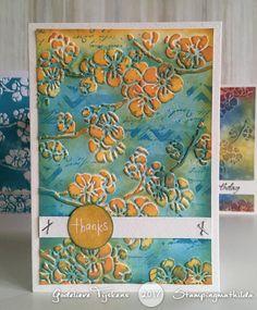 Godelieve Tijskens:  Aurelie Budding Blossom Embossing Folder inked with Distress Oxide inks