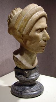 Roman marble portrait head of a woman, Flavian Period, circa 75-90 A.D.,