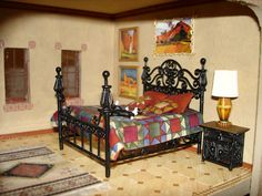 Dollhouse bed with quilt.
