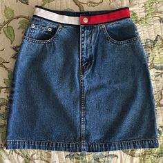 "Vintage 90s Tommy Hilfiger denim skirt Vintage 90s Tommy Hilfiger denim skirt. Has a unique red and white Tommy Hilfiger waist band. Great condition. Measurements are taken laying flat: waist: 12"" hip(widest part): 19"" length: 17"" Vintage Skirts Mini"