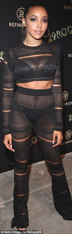 Revealing look: Singer Tinashe, 23, wore a sheer top with matching bottoms, revealing her bra and underwear