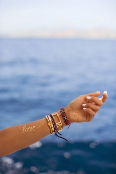 Love - all you need this Summer. But a statement gold tattoo doesn't won't hurt either.