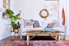 Look 1: World View  - We Styled A Couch In 3 VERY Different Ways - Photos