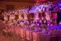 Picture-perfect #centerpieces with wonderful #uplighting!: #Weddingsbythebreakers #FredMarcusStudio
