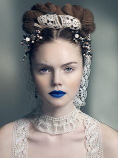 Bright blue lipstick goes so weird with the rest of the look