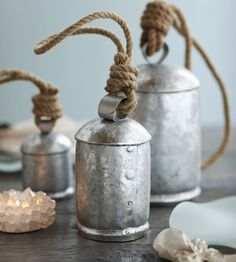 Fitted with removable wooden clackers, our temple bells coordinate perfectly with a silver-themed holiday. Dulcet- toned, the bells shimmer and glint with reflected light and resonate deep in the soul like Buddhist chants. Easy to hang from twine loops.