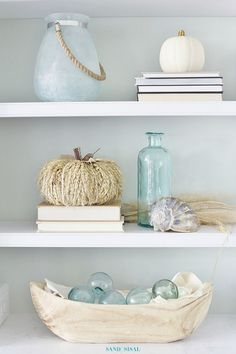 Coastal Fall Decor Home Tour with beautiful items from HomeGoods. My favorite is that wheat straw pumpkin! This would go perfect with any neutral fall color palette. ~ sponsored ~ Fall Decorating Ideas ~ White Pumpkin Decor ~ Decorating Bookshelves ~ Glass Floats