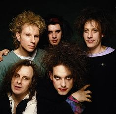 British alternative rock band The Cure at the 1991 Brit Awards where they won Best British Band. Clockwise from bottom left guitarist Porl Thompson, drummer Boris Williams, bass player Simon Gallup, keyboardist Roger O'Donnell and singer Robert Smith.