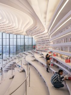 The 'Tianjin Binhai Library' 700 m² & million books). Designed by Tianjin Urban Planning and Design Institute Located in Tianjin, China. Photo by Ossip van Duivenbode. Le Corbusier Architecture, Masterplan Architecture, Bauhaus Architecture, Hospital Architecture, Zaha Hadid Architecture, Parametric Architecture, Pavilion Architecture, Architecture Portfolio, Concept Architecture
