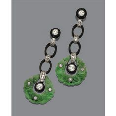 PAIR OF JADE, ONYX AND DIAMOND EARRINGS, CIRCA 1925. The long fringes composed of collet-set old European-cut diamonds within onyx rings and oval links applied with black enamel, connected by delicate links set with small old European-cut diamonds, anchored by diamond-studded carved jade rings, the total diamond weight approximately 1.75 carats, completed by gold posts.
