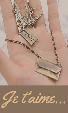 Je t'aime...I love you. This vintage style bird and envelope double chain necklace is amazing! Don't you love it?