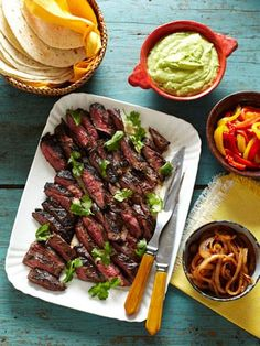 Red Curry-Marinated Skirt Steak Fajitas used lime and Domino's   hot wing sauce to marinate meat for 2 HRS. Cut strip steak in strips and put in skillet w/ a little oil, 1-onion and beef broth. Cooked 10 minutes, added T. honey, cilantro and 1 roasted red pepper from jar. salt and pepper   Served with bow ties and kolbosi cut, up and red roasted pepper from jar.