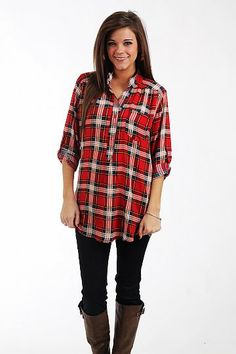 "The Kaitlyn Blouse, Red $37.50  We love the plaid on tis top! The colors are gorgeous and we love the tabbed sleeves and buttons down the bodice, plus this piece is super flexible and can be dressed up or down. Slip it on with jeans or tuck it into a skirt... we love it either way!   Fits true to size. Miranda is wearing a small.   From shoulder to hem:  Small - 29""  Medium - 30""  Large - 31"""