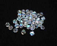 20 Clear Aurora Borealis Swarovski Bicones 4mm by WhispySnowAngel, $1.85
