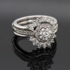 """The name """"Luce de Sol"""" means Light of the sun – or Rays of light from the sun – The band on the sides of the ring """"embrace"""" in a deep hug the centre Halo Diamond Sun Rays, Halo Diamond, Closer, Centre, Two By Two, Bands, Diamonds, Deep, Engagement Rings"""