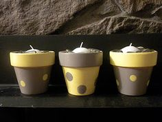 four inch terra cotta pot, paint, glass stones, candles