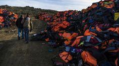 ... of thousands of life jackets on the island [Sorin Furcoi/Al Jazeera