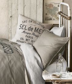 For more cheap-and-chic accessories, check out HM Home. If you're looking for rustic-industrial style and graphic textiles, you (and your wallet) will love HM Home. French Industrial, Industrial Chic, Industrial Bedroom, Rouge Paris, Estilo Interior, H & M Home, Trends Magazine, Home Collections, Bedding Collections