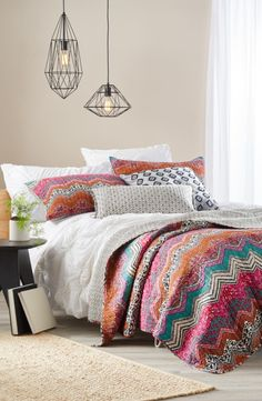 Mixed patterns create an earthy collage on this lightweight cotton quilt.