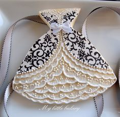 """Stunning ball gown cookies.  The black and white part is cut from a sheet of edible decorations.  (Go to wilton.com and search on """"sugar sheets"""".  Then look in """"shopping"""".)"""