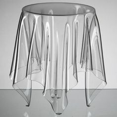 Illusion Table: Designed in 2005 by Danish designer John Brauer, the Illusion table is made out of 3mm-thick acrylic. It gives the impression that there is a tablecloth over an end table. I have always loved this!!!