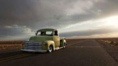 Open sky, open road in an old truck.