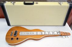 Chandler RH-2 6-String Lap Steel Guitar Includes: Carry Case*NOTE: The two end clasps on the case are broke. The middle clasp works fine and keeps the case closed.Nice lap steel! Very good condition, clean in appearance. No chips or cracks. Looks good and sounds good as well. All electronics in w...