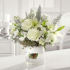 Mirroring a snow-capped mountain, our green and white arrangement of roses, Asiatic lilies, freesia and seeded eucalyptus will cap off every holiday celebration! Call us for #delivery #Vermilion #florist 440-967-9996
